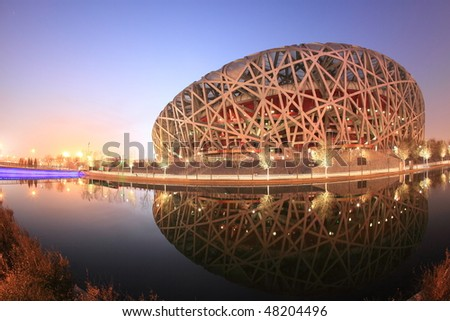 BEIJING - DECEMBER 17: the transformation of the Beijing Olympic Stadium into a ski park made from artificial snow triggered green peace activists anger on December 17, 2009 in Beijing, China. - stock photo