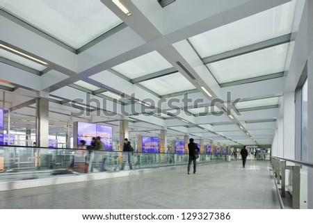 BEIJING-FEB. 21. Corridor with moving walkway, Beijing Capital Airport Terminal 3. The world's largest airport terminal has 243 elevators, escalators or moving walkways. Beijing, Feb. 21, 2013. - stock photo