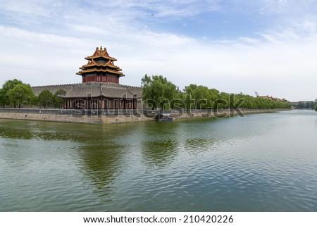 Beijing Forbidden City turret moat  - stock photo