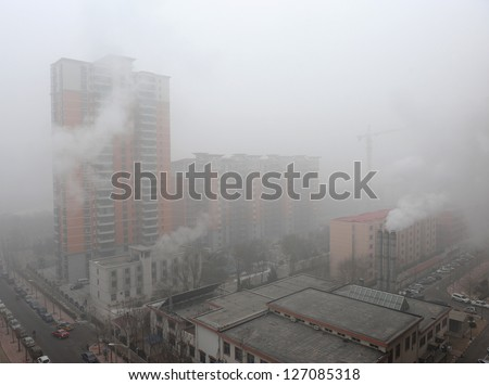 "BEIJING - JAN 12: Severe air pollution on January 12, 2013 in Beijing, China. Air quality index levels were classed as ""Beyond Index"" (PM 2.5 of over 700 micrograms per cubic meter)."