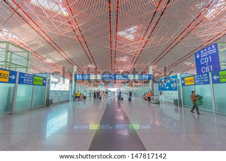 BEIJING- JULY 5, Air Main corridor of Beijing airport on July 5, 13 in Beijing . The airport has registered 488,495 annually aircraft movements and ranked 10th in the world. - stock photo