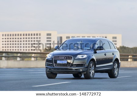 BEIJING-JULY 5. Audi Q7 SUV on the road. Global and upcoming Chinese automakers are scrambling to cash in on the explosive popularity of sport utility vehicles in China. Beijing, July 5, 2013. - stock photo