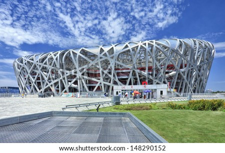 BEIJING-JULY 28. Bird's Nest on a summer day. The Bird's Nest is a stadium in Beijing, China, especially designed for use throughout the 2008 Summer Olympics and Paralympics. Beijing, July 28, 2013. - stock photo
