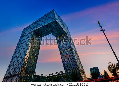 BEIJING -July. 24: CCTV Headquarters at twilight on July. 24, 2014 in Beijing, The CCTV building is a loop of six horizontal and vertical sections with a total floor space of 473,000 square meters. - stock photo
