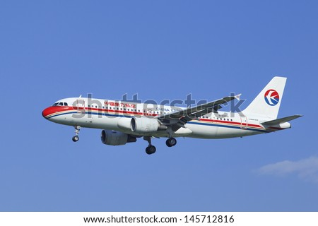 BEIJING-JULY 5. China Eastern Airbus 320-214, B-6009 landing. Airbus A320 family consists of short- to medium-range, narrow-body, commercial jet airliners up to 220 passengers. Beijing, July 5, 2013. - stock photo