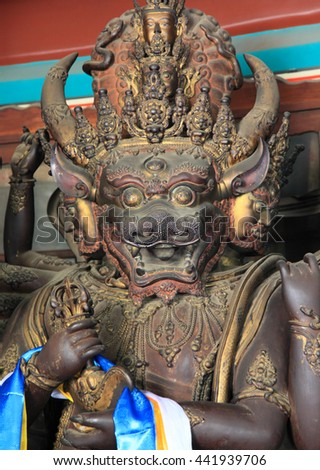 BEIJING - JULY 25, 2014 : Chinese god statue at Confucius Temple of the king on July 25, 2014 in Beijing, China. It is a landmark royal architecture and a unesco world heritage in China. - stock photo
