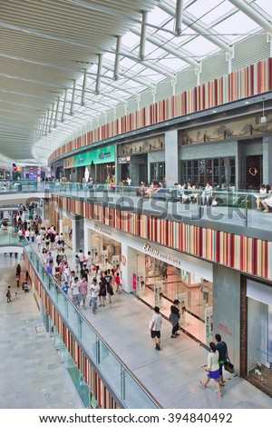 BEIJING-JULY 18, 2015. Inside Livat shopping mall. At over 172,000 sq. meters, LIVAT stands out from other malls in Beijing, not only by size, but for being invested, owned by Inter Ikea Centre Group. - stock photo
