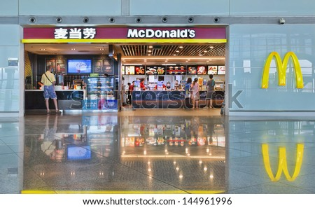 BEIJING-JULY 5. McDonald's outlet at Capital Airport. McDonald's is adding rice products to its menu for the first time in China, in a bid to better appeal to local tastes. Beijing, July 5, 2013. - stock photo