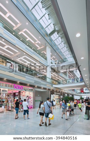 BEIJING-JULY 18, 2015. Shoppers at Livat shopping mall. Owned by Inter Ikea Centre Group, Livat has more than 400 renowned domestic and international brands like H&M, Zara, Forever 21 and Old Navy.