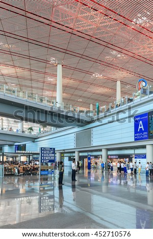 BEIJING-JULY 15, 2016. Spacious arrival area with shiny floor, Beijing Capital International Airport, Terminal 3. With 986,000 m2 it is the second largest airport terminal building in the world.