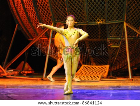 BEIJING - JUNE 5: An unidentified Beijing Acrobatics Troupe artist performs at the famous Chaoyang Theatre on June 5, 2011, in Beijing, China. - stock photo