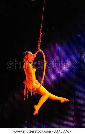 BEIJING - JUNE 5: Beijing Acrobatics Troupe artist performs at the famous Chaoyang Theatre on June 5, 2011, in Beijing, China. - stock photo