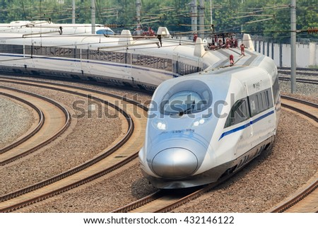 BEIJING-JUNE 5, 2016. Bullet train departs from Beijing. Past 10 years China built 20,000km high-speed rail, 20 urban public transport systems, countless roads and highways and dozens new airports. - stock photo