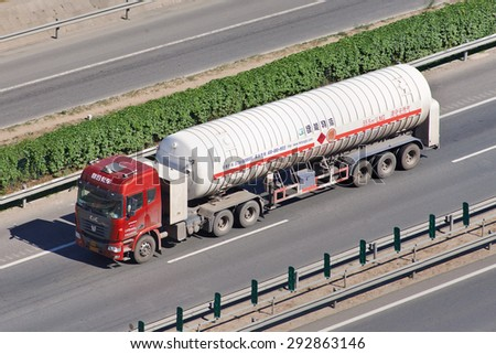 BEIJING-JUNE 30, 2015. CIMC Honto LNG transporter. CIMC, China international Marine Containers, is a leading manufacturer of trailer and semi-trailer with an annual production of over 200,000 units. - stock photo