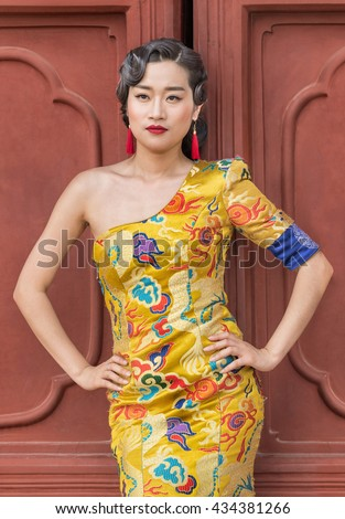 BEIJING-JUNE 9, 2016. Model poses in classic fashion. In recent years, return to traditional culture/fashion became popular. Traditional costumes and etiquettes began to appear in various occasions. - stock photo