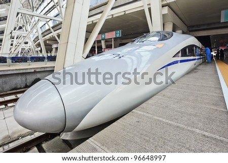 BEIJING - MAR 3: Bullet train at Beijing Railway Station South on March 3, 2012 in Beijing. China has the world's longest high-speed rail network with 9,676 km (6,012 mi) of routes in service. - stock photo