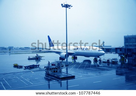 BEIJING - MAR 22:United Airline aircraft docking at Beijing Capital Airport on March 22, 2012. The airport registered 488,495 aircraft movements (take-offs & landings), ranked 10th in the world. - stock photo