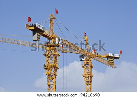 BEIJING - MARCH 26, 2011. CRCC Cranes on a construction site on March 26, 2011. CRCC stands for China Railway Construction Corporation, China's second largest state-owned construction enterprise.