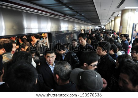 BEIJING - MARCH 15:Crowded scene of Beijing's subway during rush hour on March 15 2009 in Beijing,China. It transports about 7 million people every day. - stock photo