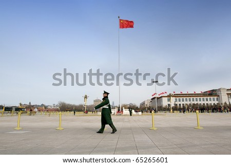 BEIJING - MARCH 12: security guards patrol on Tiananmen square during the annual National Congress on March 12, 2010 in Beijing, China.