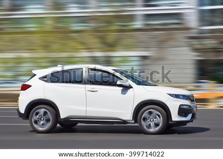 BEIJING-MARCH 30, 2016. White Honda HRV Vezel. Honda sold more than 1 million cars in China last year, beating its previously announced 2015 target of 950,000 units, according the Japanese company. - stock photo