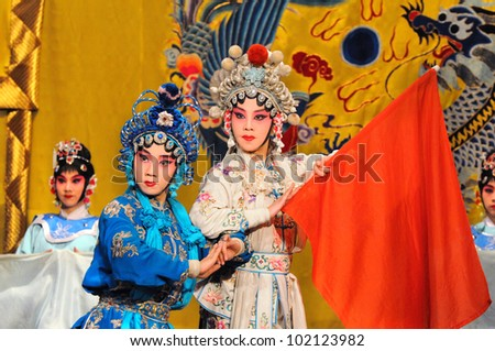 "BEIJING - MAY 7: Actors of the Beijing Opera Troupe perform the famous story ""White Snake"" at the Huguang Theatre on May 7, 2012, in Beijing, China. - stock photo"
