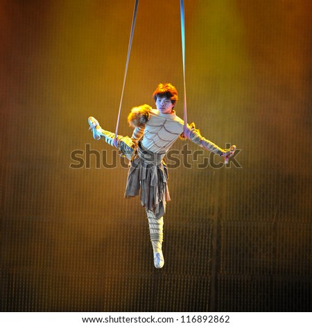 BEIJING - MAY 19: Artists of the Beijing Acrobatics Troupe perform at the famous Chaoyang Theatre on May 19, 2012, in Beijing, China. - stock photo