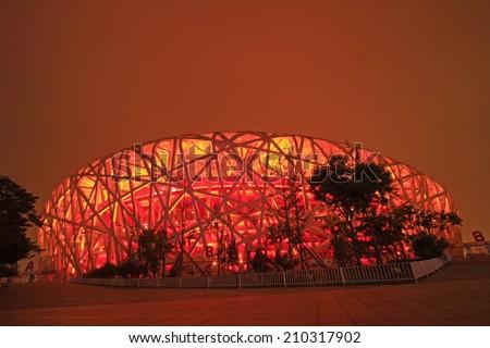 BEIJING - MAY 24: Beijing national stadium - the bird's nest at night, in the Beijing Olympic park, on may 24, 2014, Beijing, China  - stock photo