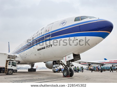 BEIJING-MAY 6, 2014. Boeing 777 on Beijing Capital Airport. Triple Seven is the world's largest twin-jet and has a seating capacity for 314 to 451 passengers, and has a range of 9,695 to 17,372 km.  - stock photo