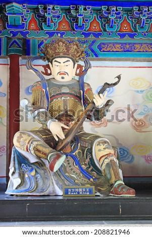 BEIJING - MAY 23: Buddhist heavenly king statues in the Beihai Park, on may 23, 2014, Beijing, China