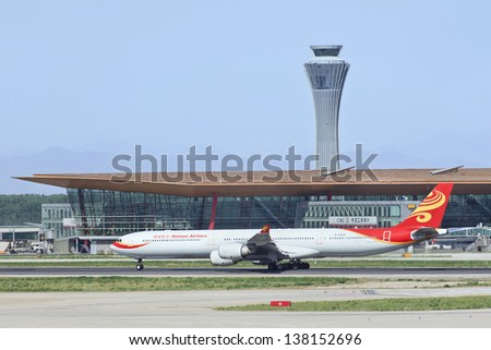 BEIJING-MAY 11. Hainan Airlines Airbus A340-642, B-6509 on Capital Airport. Long-range four-engine wide-body passenger jet airliner, 375 passengers, 440 in stretched 600 series. Beijing, May 11, 2013. - stock photo