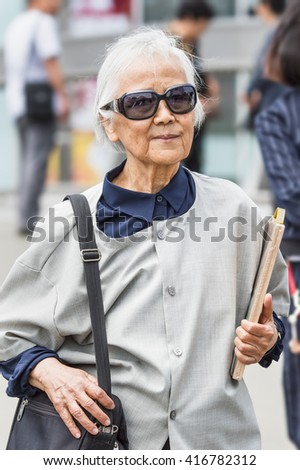 BEIJING-MAY 4, 2106. Stylish dressed old woman. China gets rapidly older. Three decades ago, only 5% of its population was over 65. Today, 123 million people, or 9% of the population are over 65. - stock photo