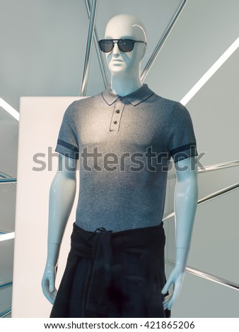 BEIJING-MAY 15, 2016. Stylish male display mannequin with sunglasses. The world's biggest clothing retailers are engaged in a fierce battle to succeed in the largest fashion market in the world.