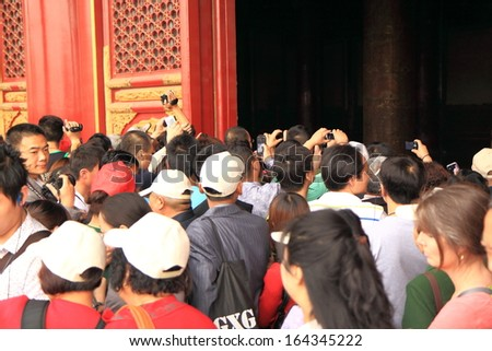 Beijing  - May 11: Tourists sightsee in Forbidden City - May 11,2012 in Beijing China. The emergence of a newly rich middle class is fueling domestic travel boom