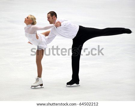 BEIJING - NOV 6 : Caitlin Yankowskas / John Coughlin of USA perform in the Pairs-Free Skating event of the SAMSUNG Cup of China ISU Grand Prix of Figure Skating 2010 on Nov 6, 2010 in Beijing, China. - stock photo
