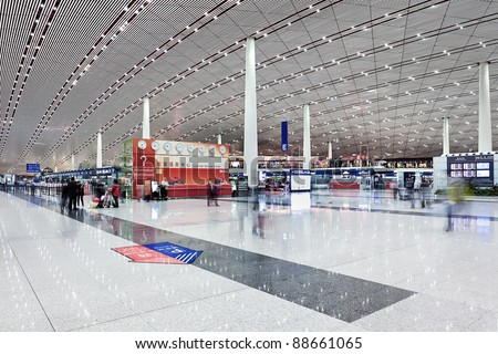 BEIJING - NOV. 10. Departure hall Beijing Capital Airport Terminal 3. The airport registered 488,495 aircraft movements (take-offs + landings), ranked 10th in the world. Beijing, Nov. 10, 2011. - stock photo