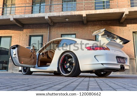 BEIJING-NOV. 8: Parked customized Porsche. Porsche may deliver more cars in China than in its German home market by 2011, according the Jebsen Group, Porsche dealer on Nov. 8, 2010 in Beijing. - stock photo