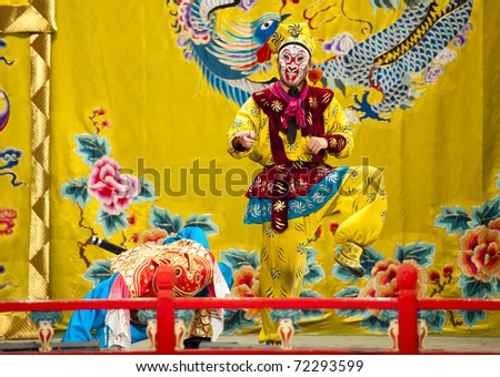 """BEIJING - NOVEMBER 16: Actors of the Beijing Opera Troupe perform the famous story """"Journey to the West"""" at the Huguang Theater on November 16, 2010 in Beijing, China. - stock photo"""