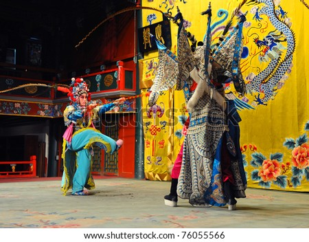 """BEIJING - NOVEMBER 16: Actors of the Beijing Opera Troupe perform the famous story """"Journey to the West"""" at the Huguang Theater on November 16, 2010, in Beijing, China. - stock photo"""