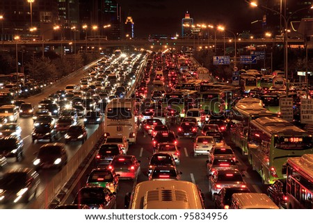 BEIJING-OCT 25: Traffic jam in Beijing's Central Business District at night on Oct 25, 2010 in Beijing, China. Beijing is expected to pass the five million vehicles on its roads by the end of the year - stock photo