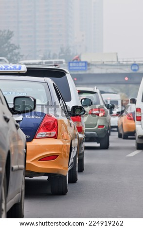 BEIJING-OCT. 19, 2014. Traffic jam in smog covered city. Beijing suffered severe air pollution which is mainly caused by exhaust emission of five million cars and coal burning in neighboring regions.