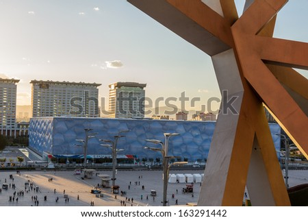 BEIJING - OCTOBER 13: View of Beijing Water Cube at sunset on Oct 13, 2013 from Birds nest, Beijing, China. It hosted Olympic swimming and diving events.  - stock photo