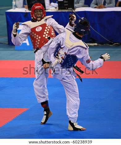BEIJING-SEP 02:Gwladys Epangue of France(L) fights against Bianca Walkden of Great Britain(R) during the Taekwondo competitions of the SportAccord Combat Games 2010 on Sep 02,2010 in Beijing,China - stock photo
