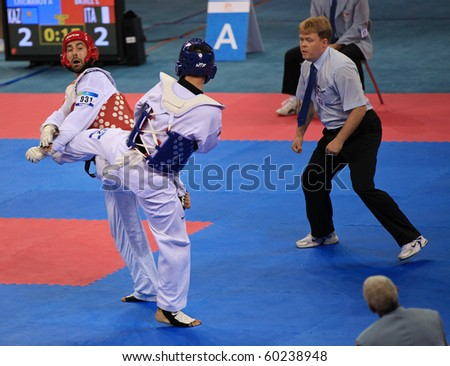 BEIJING-SEP 02:Leonardo Basile of Italy(L) fights against Arman Chilmanov of Kazakhstan(R) during the Taekwondo competitions of the SportAccord Combat Games 2010 Beijing on Sep 2,2010 in Beijing,China - stock photo