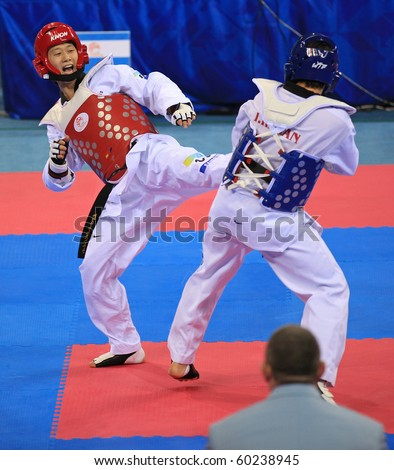 BEIJING-SEP 02: Taejin Son of Korea (L) fights against Reza Naderian of Iran (R) during the Taekwondo competitions of the SportAccord Combat Games 2010 Beijing on Sep 02, 2010 in Beijing, China - stock photo