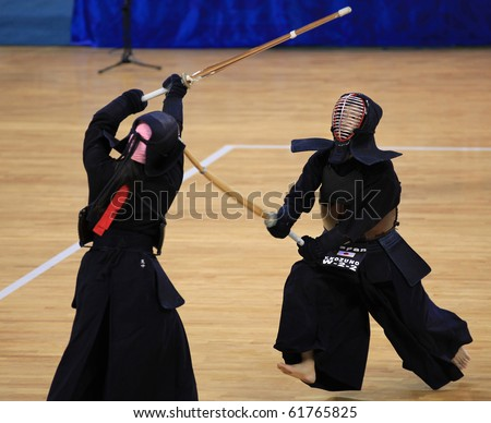 BEIJING-SEP 03: Yuka Kozuno of Japan(R) fights against E.M. Onaka of Brazil(L) during the Kendo competitions of the SportAccord Combat Games 2010 Beijing on Sep 03, 2010 in Beijing, China - stock photo