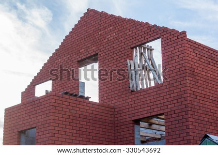 being built red brick house - stock photo