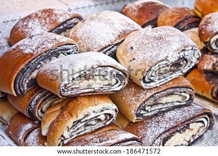 Bejgli - traditional hungarian christmas cake on christmas fair - stock photo