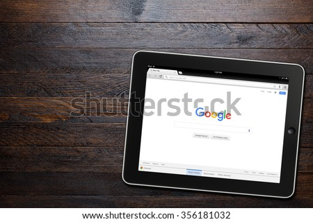 BEKASI, INDONESIA - DECEMBER 29, 2015: Google website displayed on iPad. Google.com domain was registered September 15, 1997. - stock photo
