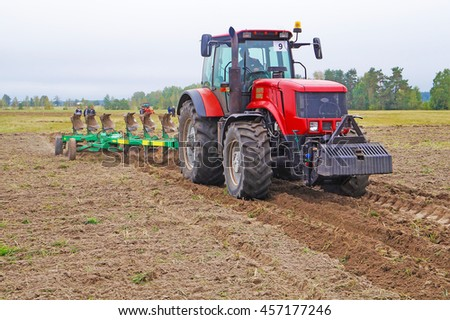 Belarus, Bobruisk district, September 9: Tractor plowing a field. First harrow, September 9, 2015 in Bobruisk district, Belarus.